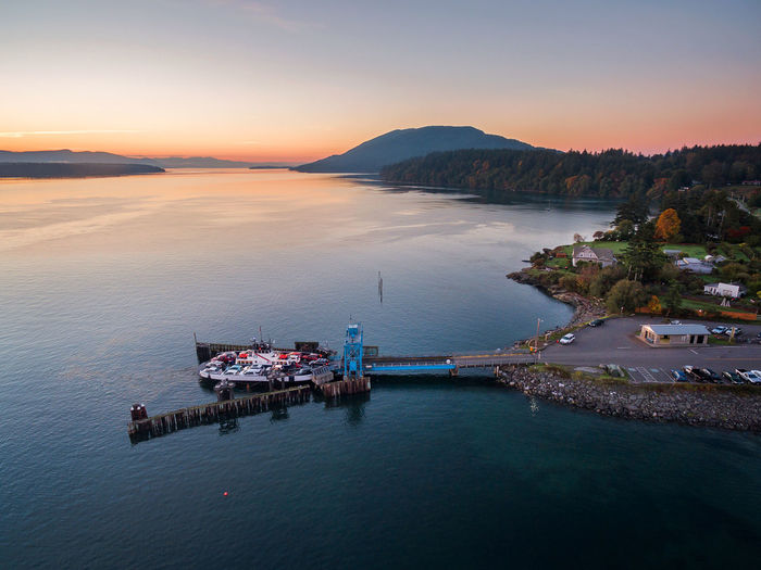 Lummi Island Ferry. Aerial view of the Lummi Island ferry and dock on an autumn morning. Water Sky Sea Transportation Nautical Vessel Scenics - Nature Beauty In Nature High Angle View No People Waterfront Mountain Mode Of Transportation Travel Outdoors Ferry Boat Lummi Island Puget Sound Pacific Northwest  San Juan Islands Dock Salish Sea Sunrise Nature Washington