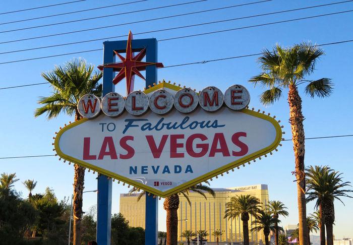 Las Vegas Sign Las Vegas Blvd Mandalay Bay Hotel Clear Sky Communication Day Mandalay Bay Nevada No People Outdoors Palm Tree Signboard Text Tree