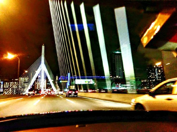 The Week On EyeEm Perspective Photoghraphy Transportation Illuminated Car Night Architecture City Bridge - Man Made Structure Travel Destinations Cityscape Suspension Bridge Outdoors Boston, Massachusetts Traffic Road Built Structure Land Vehicle City Street City Life Light Trail Modern Travel