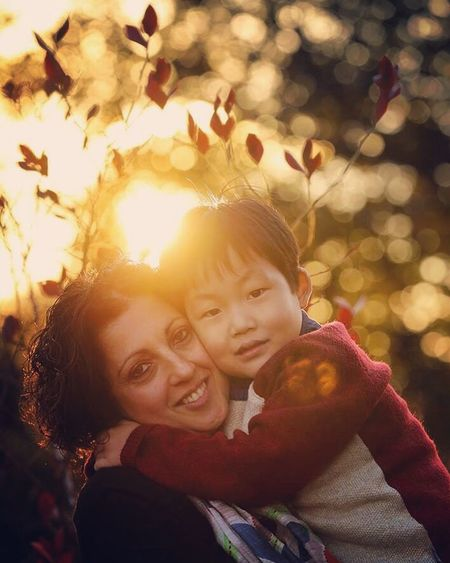 Smiling Togetherness Looking At Camera Family Portrait Happiness Embracing Love Family With One Child Autumn Nature Cheerful Boys Child Childhood Leaf Portrait Of A Woman Portrait Photography PortraitPhotography