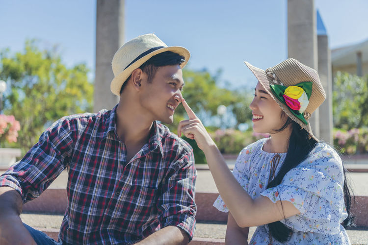 Close-up of young couple wearing hat