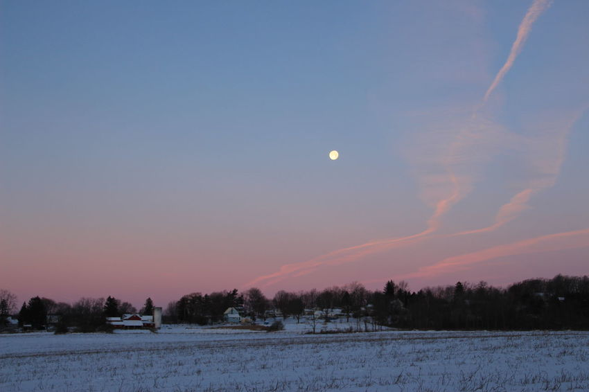 Super moon setting as the sun throws some color into the western horizon in upstate NY Astronomy Beauty In Nature Cold Temperature Fingerlakesregion Landscape Moon Nature No People Scenics Sky Snow Upstate New York Winter