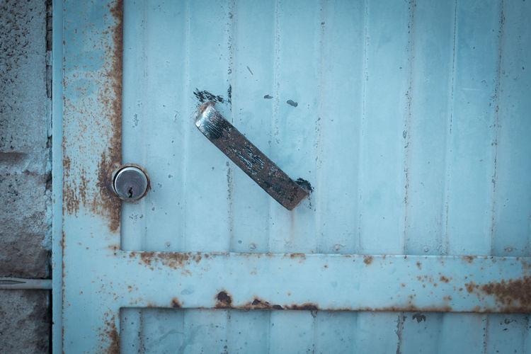 Close-up of old blue metal door
