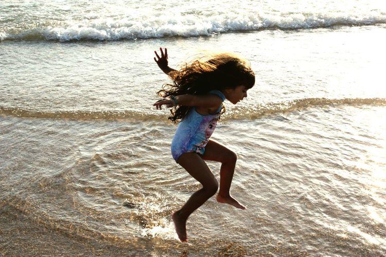 High angle view of girl playing on beach