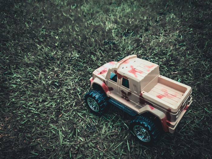 High angle view of toy car on field