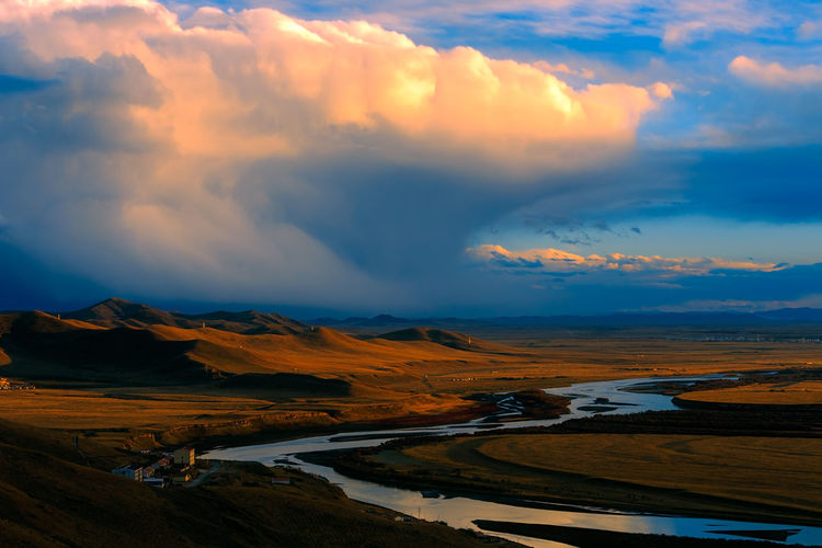 Sunset over the Yellow River in Gansu, China Autumn Awe Beauty In Nature Bright China Cloud - Sky Colorful Dramatic Sky High Landscape EyeEmNewHere Meadow Mountain Nature No People Outdoors Peak River Scenics Sunset Tranquil Travel Valley Water Winding