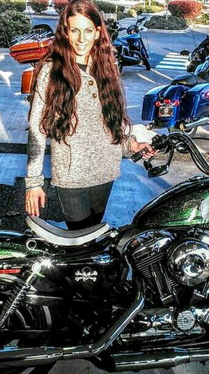 Dreaming! Dream Harley Looking At Camera Long Hair One Person One Woman Only Smiling Happiness Beauty Outdoors Harley Davidson Sunlight Sport Sparkly Green White Wall Tires Pacificnorthwest Standing Posing For The Camera Travel Motorcycle Transportation