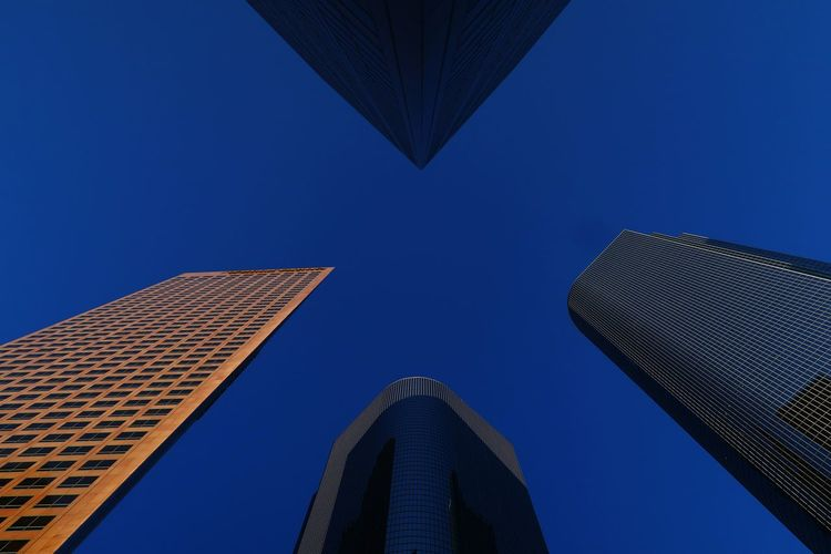 Shapes Shapes Skyscraper Blue Sky Sunset Los Ángeles DowntownLA Downtown Downtown District X City Clear Sky Modern Skyscraper Blue Business Finance And Industry Sky Architecture Building Exterior Built Structure Office Building Tower Urban Skyline Financial District  Office Building Exterior Downtown District Skyline Cityscape