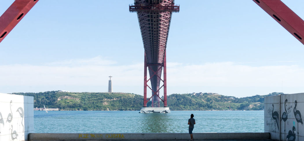 Lookingup Looking To The Other Side Riverside Tagus River Bridge Lisbon ManThe Traveler - 2015 EyeEm Awards Seeing The Sights My Best Photo 2015 The Tourist Learn & Shoot: Balancing Elements Original Experiences