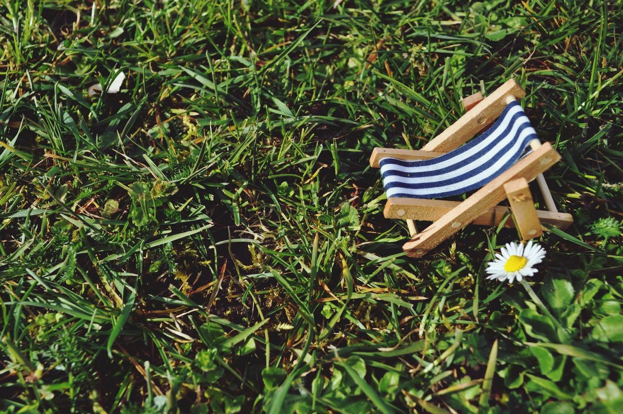 Toy deck chair on grass