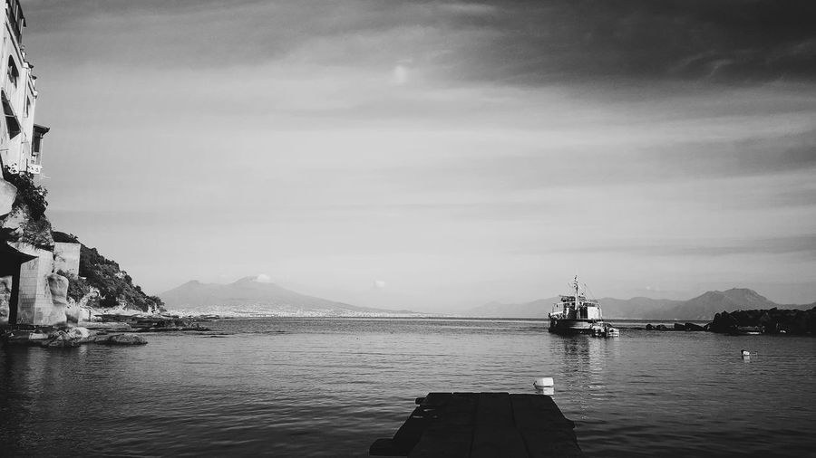 Napoli Architecture Beauty In Nature Blackandwhite Cloud - Sky Day Harbor Mode Of Transport Mountain Mountain Range Napoliphotoproject Nature Nautical Vessel No People Outdoors Sailing Scenics Sea Sky Tranquil Scene Tranquility Transportation Travel Destinations Water Waterfront EyeEmNewHere