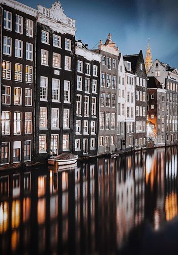 Cold evening in Amsterdam Holland Amsterdam Building Exterior Architecture Built Structure Building City Sky Residential District Water No People Reflection Outdoors Nature Window Night Waterfront River Pattern Apartment