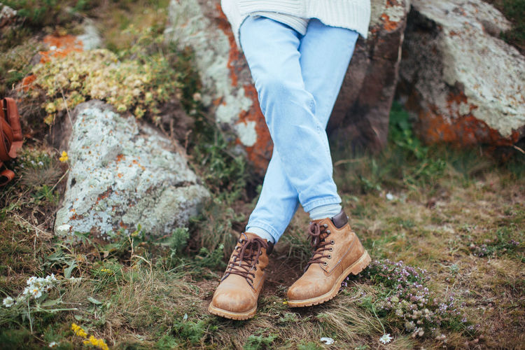 Low section of woman wearing boots
