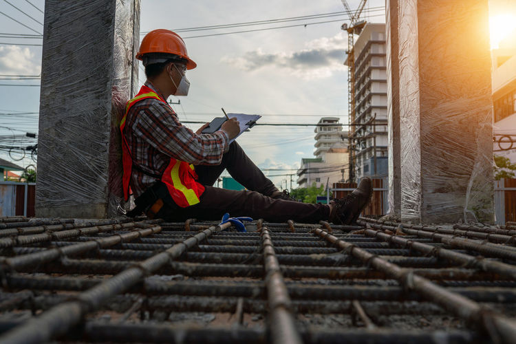 Man working at construction site during sunset