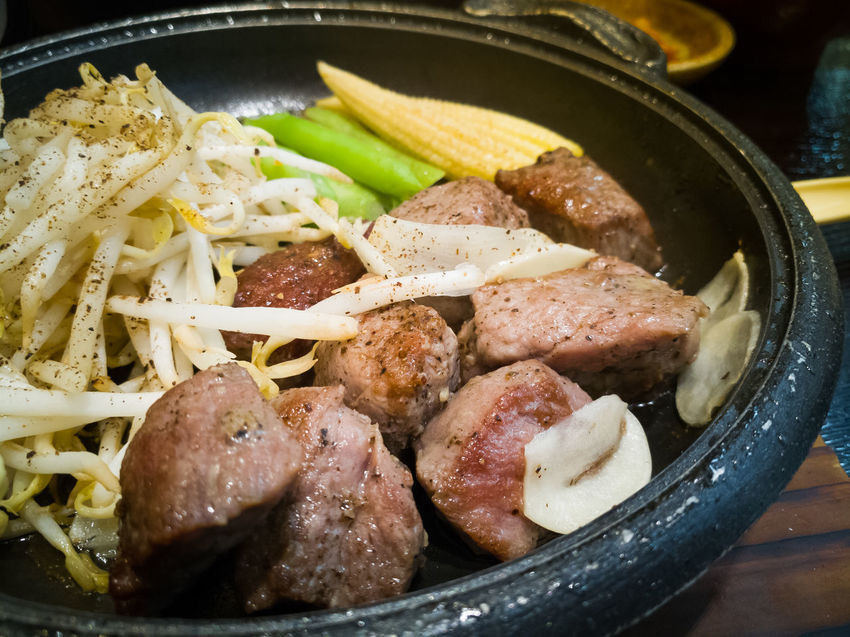 The meat on hot plate in Japanese restaurant. Hot Plate Japanese Food Japanese Restaurant Japanese Style Close-up Food Food And Drink Freshness Hot Air Balloon Indoors  Meat Meat Love No People Ready-to-eat