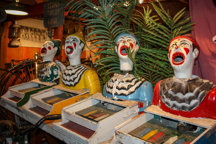 Old fairground game clowns in a museum Circus Fairground Attraction Pay To Play Retro Art And Craft Building Clowns Craft Creativity Day Decoration Game Human Representation Indoors  Male Likeness Museum Open Mouthed Representation Sculpture Sideshowcollectibles Spirituality Win A Prize Win The Game
