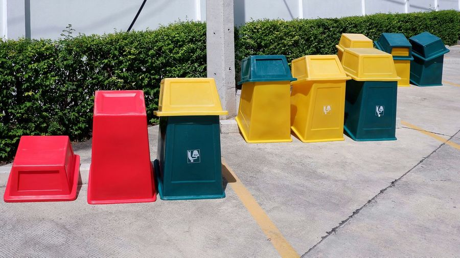 Various colors of waste sorting garbage bins upside down on concrete floor to drying in sunshine on cleaning process before using again Recycling Recycle Upside Down Red Green Space Garbage Bin Safe Environment Colorful Icon Protection Waste Sorting Bins Trashcan Container Upside Down Cleaning Process Drying In Sunshine Concrete Cement Floor EyeEm Selects Multi Colored Yellow Shadow Various