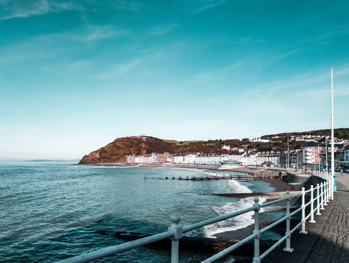 Aberystwyth seafront Irish Sea Wales UK Turquoise Colored Promenade Winter Seaside Resort Town TOWNSCAPE Water Sea Beach Blue Clear Sky Sand Sky Horizon Over Water Mast Seascape Wave Bay Of Water