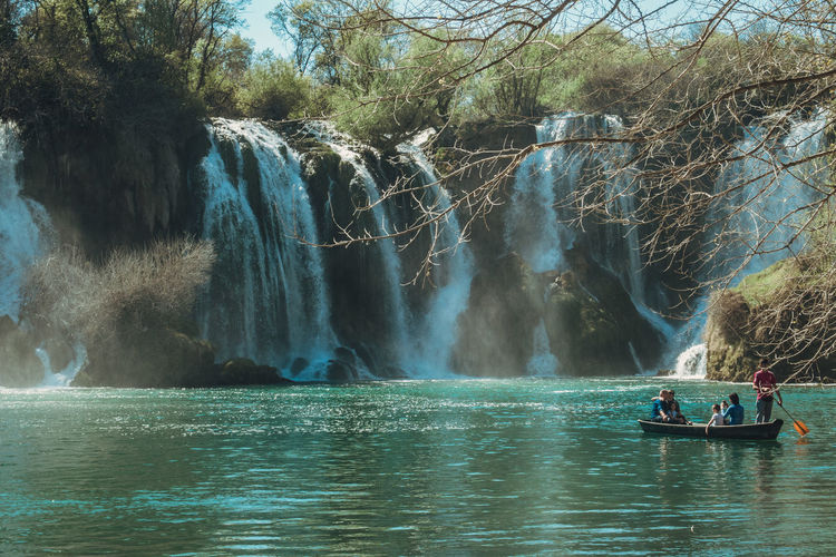 Beauty In Nature Boat Day Flowing Water Group Of People Kravice Kravice Waterfalls Lifestyles Men Mode Of Transportation Motion Nature Nautical Vessel Outdoors Plant Real People River Scenics - Nature Transportation Travel Tree Water Waterfall Waterfront My Best Travel Photo