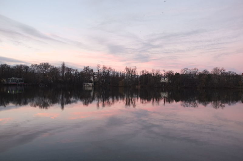 Reflection Tranquility Water Sky Beauty In Nature Tranquil Scene Scenics - Nature Lake Cloud - Sky Waterfront Sunset Tree No People Idyllic Nature Symmetry Non-urban Scene Plant Standing Water Reflection Lake Weißensee