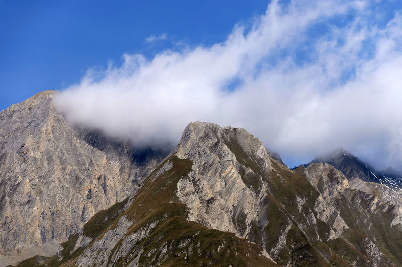 Rocky mountains against blue sky and clouds