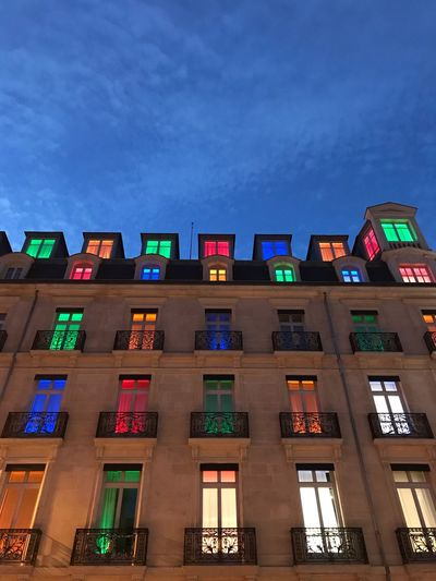 Les fenêtres Illuminated Architecture Building Exterior Built Structure Night Low Angle View No People Sky City Dusk Building Nature Residential District Outdoors Window Multi Colored Travel Destinations In A Row Blue Neon