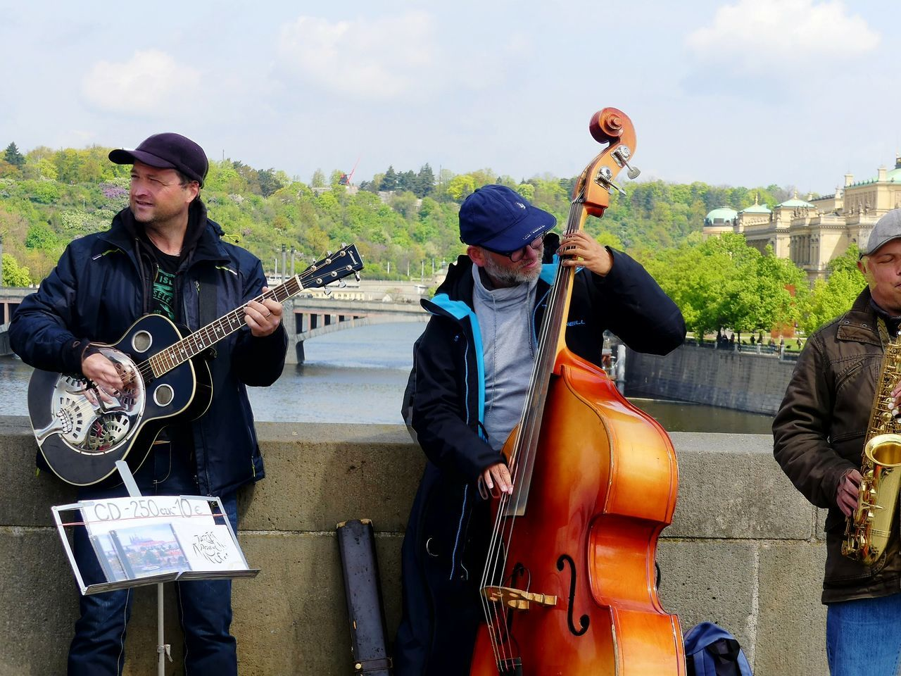 music, playing, guitar, musical instrument, musician, real people, performance, arts culture and entertainment, day, outdoors, standing, men, togetherness, occupation, sky, people