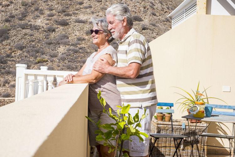 Senior Couple Standing In Balcony
