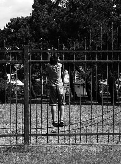 Boys Childhood Nature One Person Outdoors Real People Standing EyeEmNewHere Connected By Travel Blackandwhite Photography Blackandwhite Black And White Street Photography Streetphotography A Wish Behind The Wall Trip Photo Streetphoto_bw Streetphoto Streetphotographer Black And White Friday Press For Progress