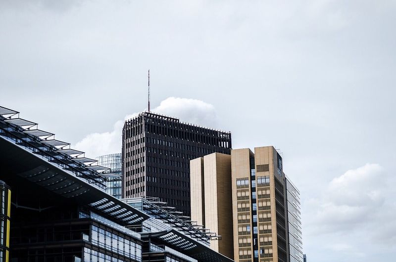 Low angle view of modern buildings against sky at potsdamer platz