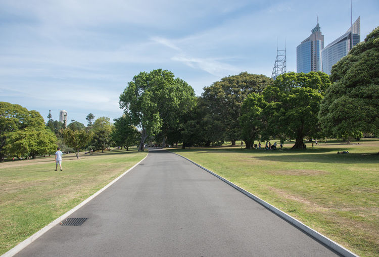 Sydney,NSW,Australia-November 20,2016: Footpath through the springtime greenery at the Royal Botanic Gardens with tourists and architecture in Sydney, Australia. Architecture Australia Botanical Gardens Cityscape Exploring Footpath Grass Growth Path Picnic Royal Botanic Gardens Skyline Tourist Attraction  Tourists Tree Diminishing Perspective Greenery Incidental People Landscape Leisure Activity Lush Foliage Park Spring Sydney Travel Destinations