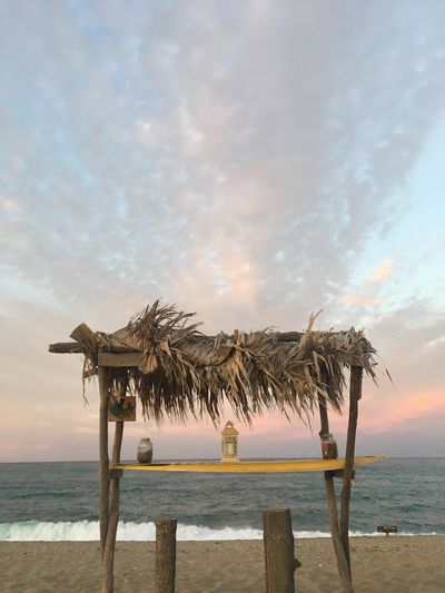 EyeEm Selects Beach Sea Water Sky Horizon Over Water Nature Shore Thatched Roof Sand Tranquility Beauty In Nature Cloud - Sky Tranquil Scene Scenics Outdoors No People Day Palm Tree Shelter Tree Black Sea