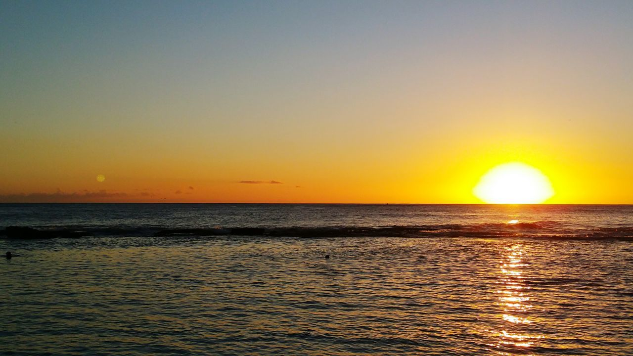 sunset, sea, sun, scenics, beauty in nature, water, nature, tranquil scene, tranquility, orange color, horizon over water, idyllic, reflection, sky, yellow, silhouette, no people, outdoors, rippled, sunlight, waterfront, beach, clear sky