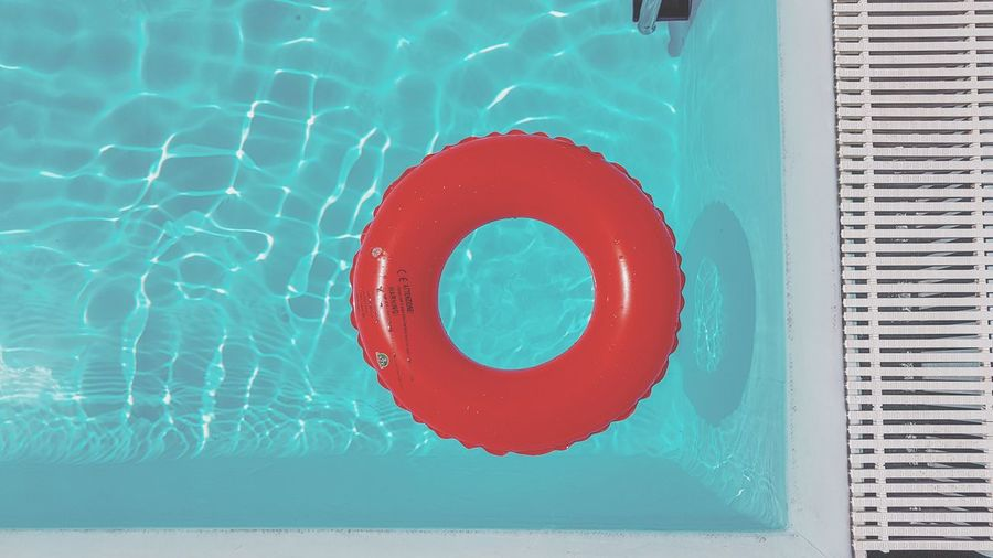 High angle view of red floating on swimming pool