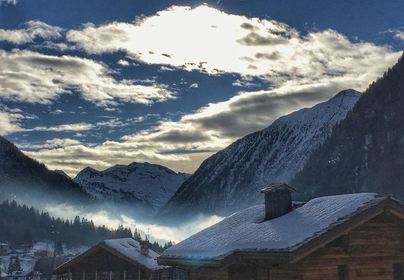 Mountain Mountain Range Snow Built Structure House Winter Building Exterior No People Cold Temperature Sky Beauty In Nature Snowcapped Mountain Outdoors Day Shades Of Winter