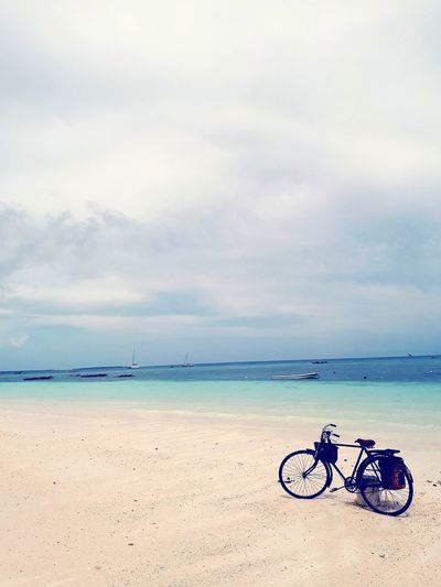Beach Sea Water Sky Tranquility Beauty In Nature Bicycle Tranquil Scene Lone Bike Blue