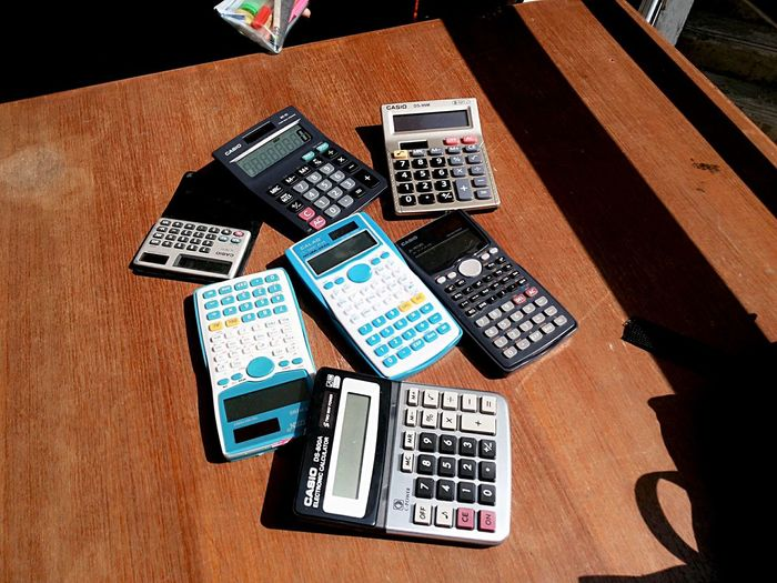 High angle view of calculators on table