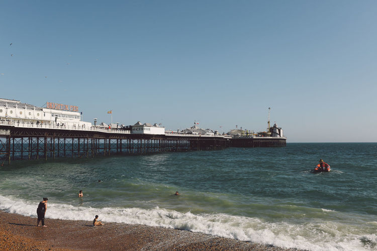 Brighton Palace Pier In Sea Against Clear Sky