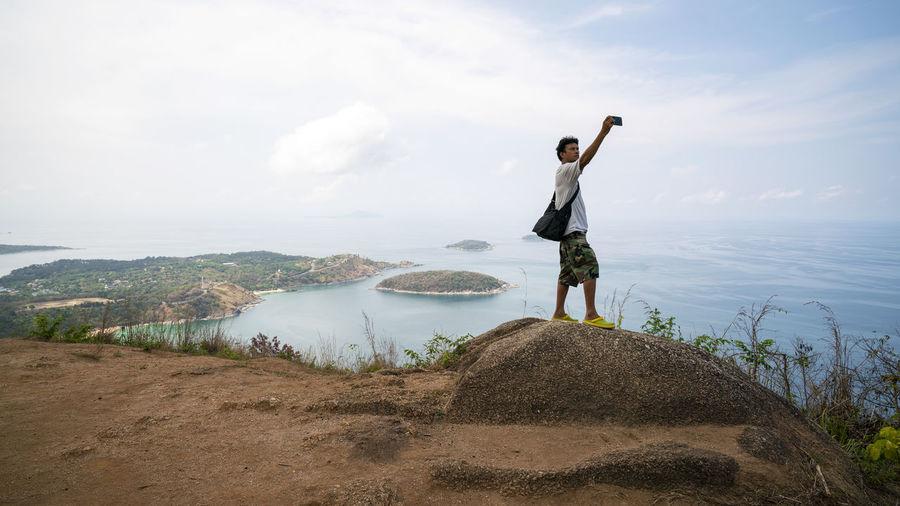 Man taking selfie while standing on mountain
