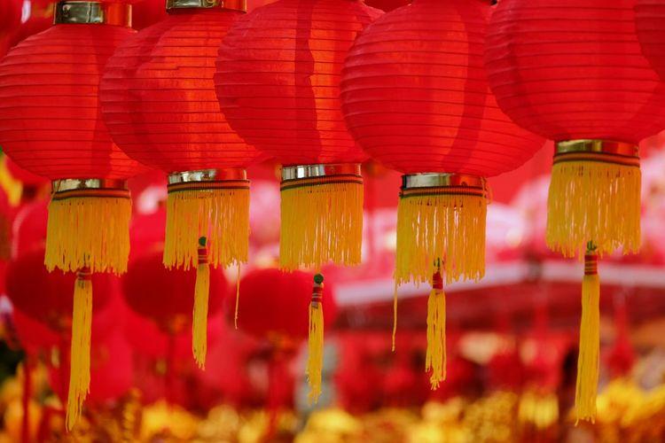 Lanterns hanging in row