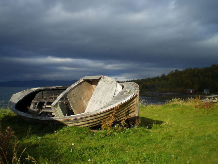 Lay Down Rotten Abandoned Alta Beach Boat Cloud - Sky Clouds Day Europe Grass Holidays Nature No People Norway Outdoors Rotten Sky Storm Cloud Time Traveling Wreck