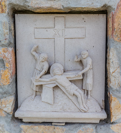 Close-up of sculpture on wall of building