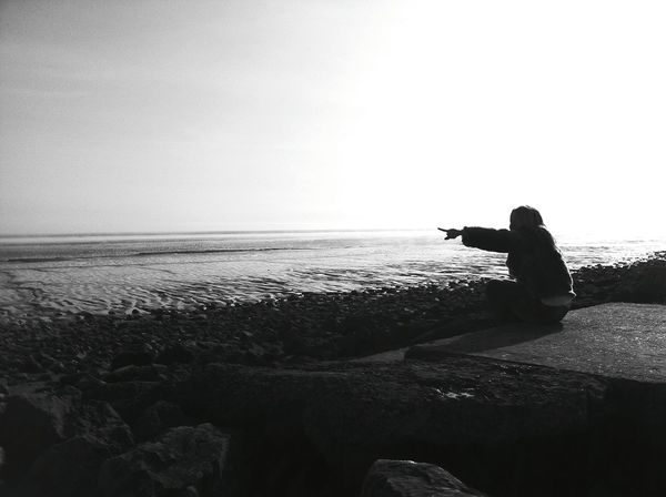 Silhouetta One Person Adult Beach One Woman Only Sand Nature Day Only Women Horizon Over Water Outdoors South Wales Coast Tidal Tide Mudflat Mudflats Severn Estuary Severn Adults Only Adult Clear Sky Pointing Silhouette Shadow Contrast