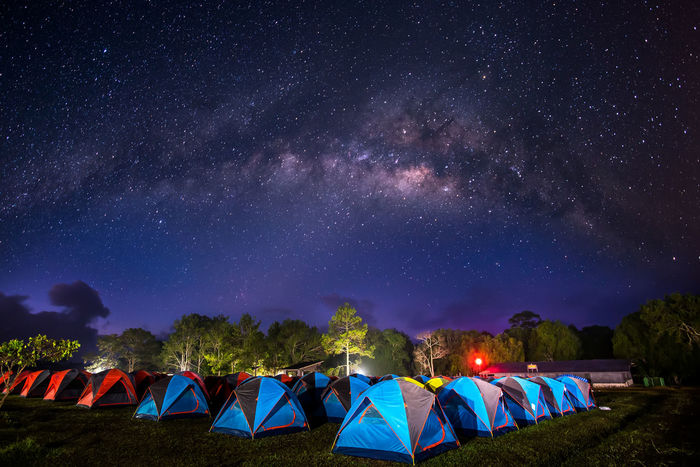 Milky Way Galaxy on Tourist Tent camping on the top of Phukradueng, Loei province, Thailand Before sunrise Image exposure with long contain some grain or noise, and soft focus. Darkness Solar Trees Astronomy Beauty In Nature Galaxy Illuminated Landscape Nature Night No People Outdoors Scenics Shelter Sky Skyscraper Star - Space Stars Tent Tent Camping Tranquility Tree