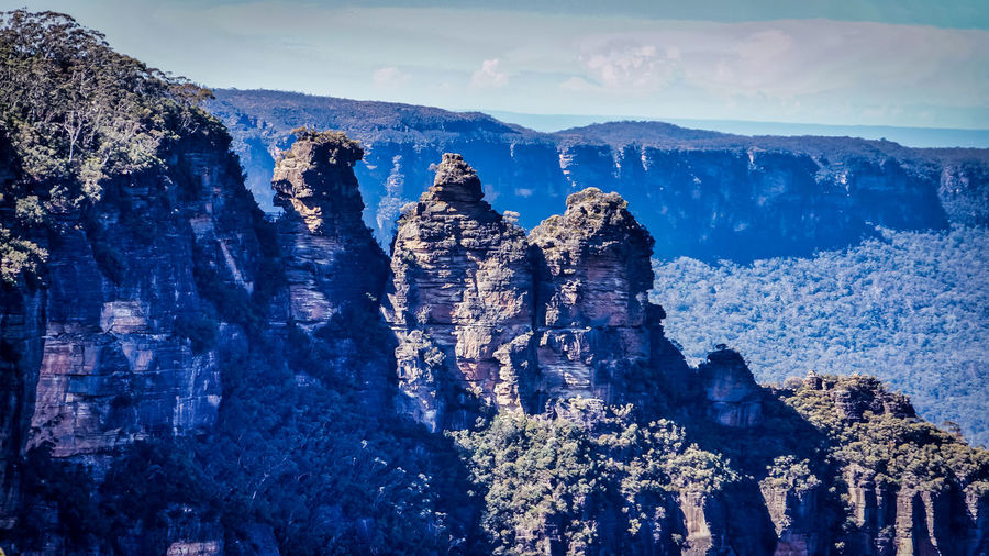 Scenic view of the Three Sisters sandstone rock formation at Blue Mountains located in New South Wales, Australia Blue Mountains Rock Three Sisters Blue Mountains Beauty In Nature Day Landscape Mountain Nature No People Outdoors Sandstone Scenics Sky