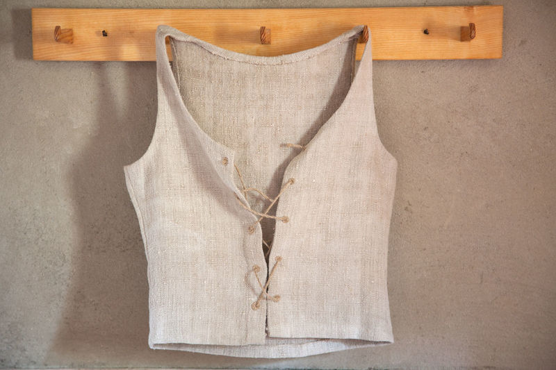 Close-Up Of Waistcoat Hanging On Wooden Hook