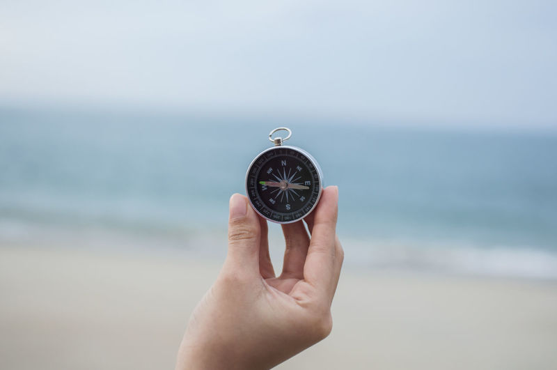 Compass in hand Adult Beach Clock Clock Face Close-up Day Focus On Foreground Holding Horizon Over Water Hour Hand Human Body Part Human Hand Minute Hand Nature Navigational Compass One Person Outdoors People Sea Sky Time Watch Water Wristwatch Young Adult