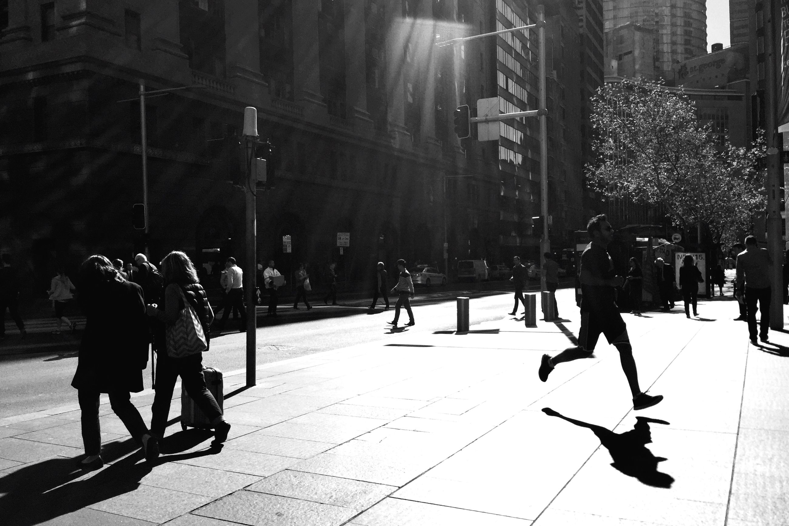 walking, men, street, lifestyles, city, person, city life, full length, large group of people, building exterior, rear view, leisure activity, sidewalk, city street, built structure, architecture, road, tree, on the move