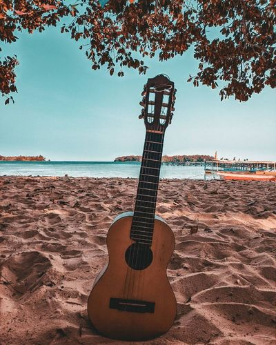 View of guitar on beach