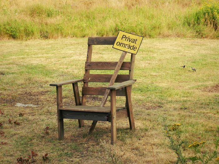 Norway Absence Bench Chair Communication Day Empty Field Grass Green Color Land Landscape Nature No People Outdoors Plant Seat Sign Text Western Script Wood - Material
